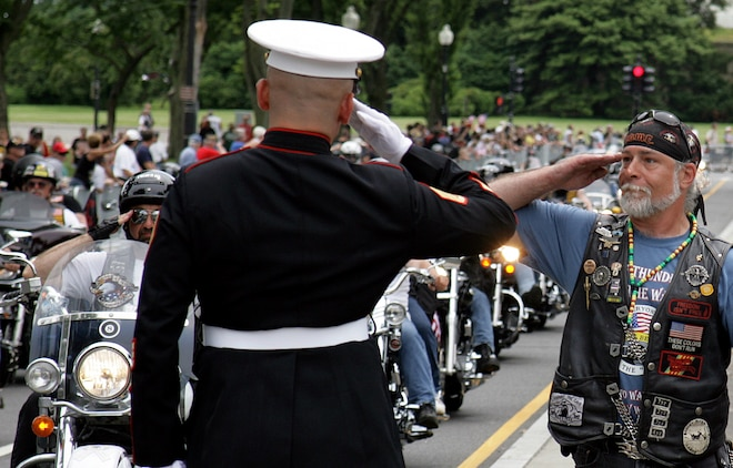 Staff Sgt. Tim Chambers exchanges a salute with a Vietnam veteran during the 22nd annual Rolling Thunder May 24. This Memorial Day weekend, Chambers stood as the embodiment of America's generations of service members to show respect and compassion as he's done for the past seven years.