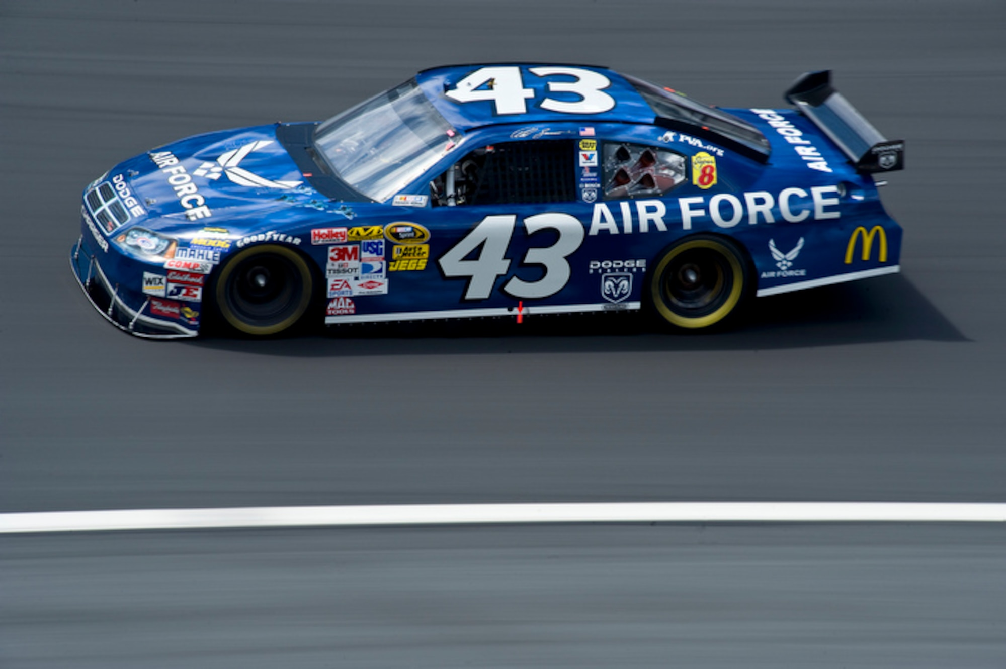 Reed Sorenson, NASCAR driver of the Richard Petty Motorsports #43 Air Force Dodge Charger, races around the Lowe's Motor Speedway at 186 mph during Coca-Cola 600 Sprint Cup race May 25. The #43 was painted in an Air Force paint scheme as a Salute to the Military for Memorial Day. (U.S. Air Force photo by/Staff Sgt. Bennie J. Davis III)