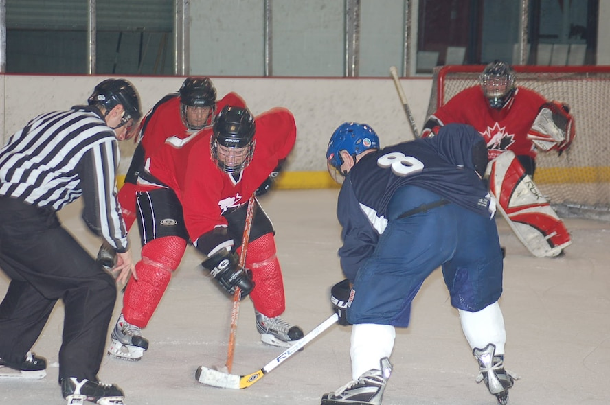 The 552nd Air Control Wing's Canadian Component hockey team squared off against their fellow American Airmen in the first annual Can/Am Cup May 15. (Photo Courtesy of Mr. John Banks)