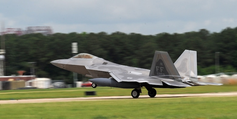 LANGLEY AIR FORCE BASE, Va. – An F-22A Raptor from the 94th Fighter Squadron takes off here May 26 for Kadena Air Base, Japan.  More than 280 Langley Airmen and 12 F-22A Raptors depart this week for their Air Expeditionary Force deployment, which demonstrates the continued U.S. commitment to fulfill its security responsibilities throughout the Western Pacific.  This is the first overseas deployment for the 94th Fighter Squadron since transitioning to the F-22.  (U.S. photo/Senior Airman Zachary Wolf)
