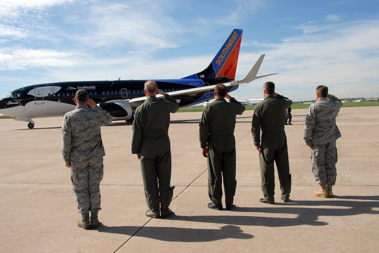 Senior Leadership from the Colorado National Guard salute the aircraft as it taxiis for departure.  More than 30 members of the 140th Security Forces Squadron, 140th Wing, Colorado Air National Guard, will deploy for six months. The unit will perform security for personnel and assets while in the U.S. Central Command Area of Operations.