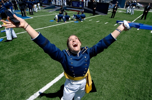 Newly commissioned 2nd Lt. Ashleigh Peck celebrates following graduation from the U.S. Air Force Academy May 27 at Falcon Stadium.  She is slated to become an Air Force public affairs officer.  (U.S. Air Force photo/Dennis Rogers)