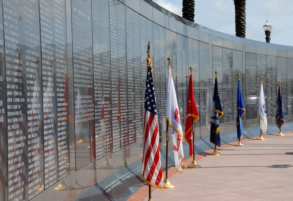 The Untied States and Military Services flags line the Veteran's Memorial Wall at the City of Jacksonville's Memorial Day Tribute to fallen heroes at the Veteran's Memorial Wall in downtown Jacksonville, Fla. May 25, 2009.(Air National Guard Photo by Staff Sgt. Jaclyn Carver)