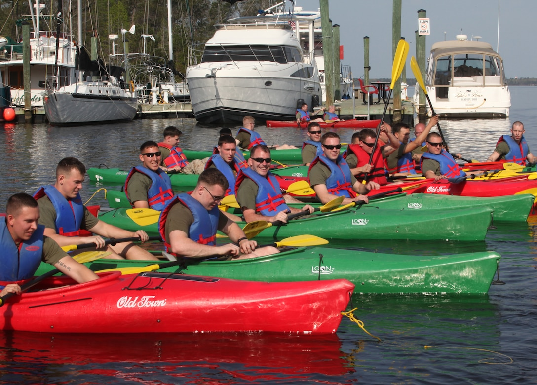Marines and sailors with Headquarters Battalion, 2nd Marine Division, ready their kayaks at the starting point at the Gottschalk Marina aboard Marine Corps Base Camp Lejeune, N.C., April 8, 2011.  The race was one of the first events that make up the Comander's Cup, a battalion-wide tournament.
