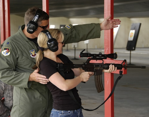 Lt. Col. John York assists Dr. Jennifer Rotruck with a Colt AR-15 during the firearms portion of  Air Forces Northern Safety Day.  U.S. Air Force photo by Master Sgt. Jerry Harlan