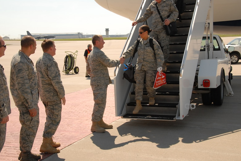 TSgt Kristina Kapaun, of the KSANG 184th Intelligence Wing's 134th Air Control Squadron, is the first to be greeted by the Kansas Adjutant General, Maj Gen Tod Bunting, at McConnell AFB after serving on deployment at Joint Base Balad, Iraq.