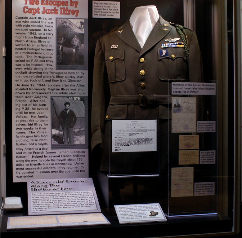 DAYTON, Ohio - Capt. Jack Ilfrey's service coat. His winged boot for evading in France is on the left breast pocket. This is part of the Winged Boot: Escape and Evasion in World War II exhibit in the World War II Gallery at the National Museum of the U.S. Air Force. (U.S. Air Force photo)