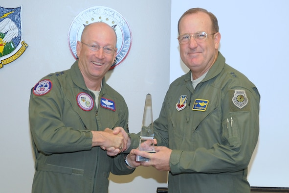 Gen. Gene Renuart presents the Partridge-Slemon award to Maj. Gen. Hank Morrow, commander of Continental U.S. NORAD Region May 7. CONR was designated NORAD's most outstanding unit in 2008 for its support of the common defense and partnership in protecting the U.S. and Canadian homelands.