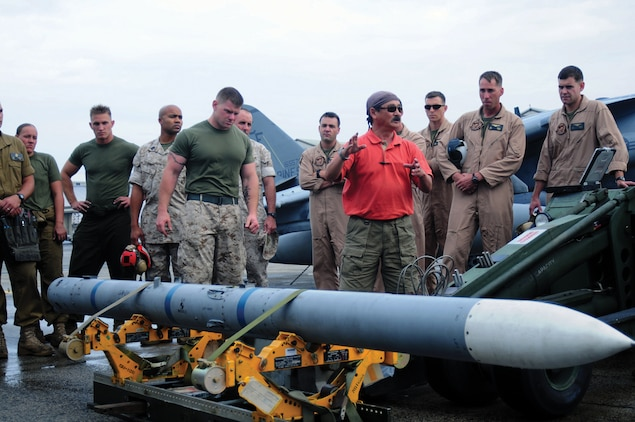 Joe Hill, an ordnance technical representative, explains the mechanics of the advanced medium-range air-to-air missile to aviation ordnance technicians of Marine Attack Squadron 211 at Marine Corps Air Station Iwakuni, Japan, May 28, 2009.(Photo by Lance Cpl. John M. Raufmann)