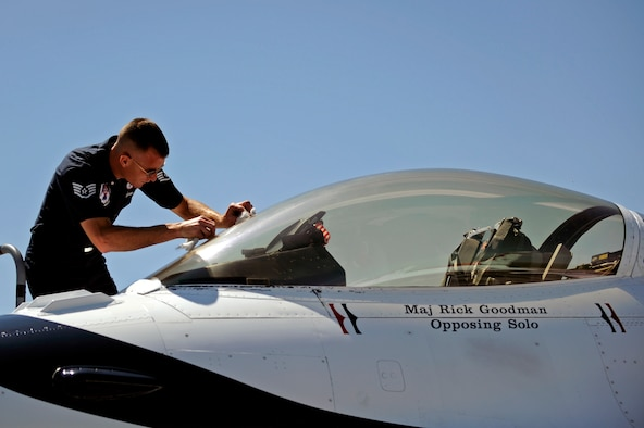 Staff Sgt. Jeremy Jackson, U.S. Air Force Thunderbirds dedicated crew chief on Thunderbirds No. 7 aircraft, cleans the canopy of the F-16 Fighting Falcon here, May 29, for the upcoming Dakota Thunder 2009 open house and air show here.  The Thunderbirds reinforce public confidence in the Air Force and demonstrate the professional competence of Air Force members to the public. (U.S. Air Force photo/Airman 1st Class Matthew Flynn)