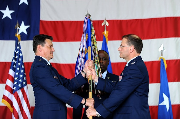 Maj. Gen. Frank Padilla (left), 10th Air Force commander, passes the guidon to Col. Herman Brunke, 926th Group commander, during the group's change of command ceremony May 29. Colonel Brunke takes command of the 926th GP after being the Division Chief, Global Power Programs & Requirements, Headquarters Air Force Reserve Command, Robins Air Force Base, Georgia. (Photo by Lawrence Crespo, 99th Air Base Wing public affairs)