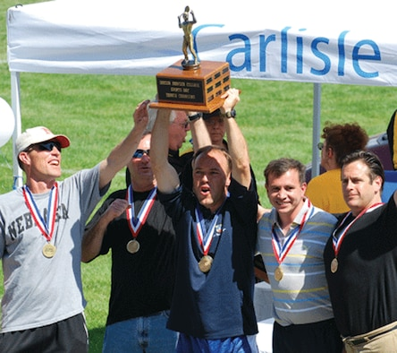 """Taking first place at the Jim Thorpe Sports Days in tennis are (from left) Lt. Col. Jeffrey Hinrichs, Col. James """"Keith"""" McKenzie, Lt. Col. Cedric """"MC"""" Gaudilliere, Lt. Col. """"Lalo"""" Ajuria-Benavides and Team Coach Dr. Gary Schaub. (Courtesy photo)"""