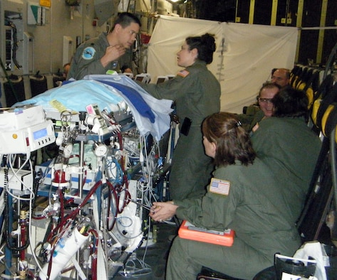 Lt. Col (Dr.) Dan Dirnberger, director neonatal intensive care, and Maj. (Dr.) Melissa Tyree, director of ECMO transport provide care to a critically ill infant during the flight from Kadena Air Base, Japan to San Antonio, Texas May 26.  The infant required more immediate and long term cardiac care than was available at the U.S. Naval Hospital in Okinawa.  Colonel Dirnberger and Major Tyree are assigned to the 59th Maternal/Child Care Squadron. (U.S. Air Force photo)