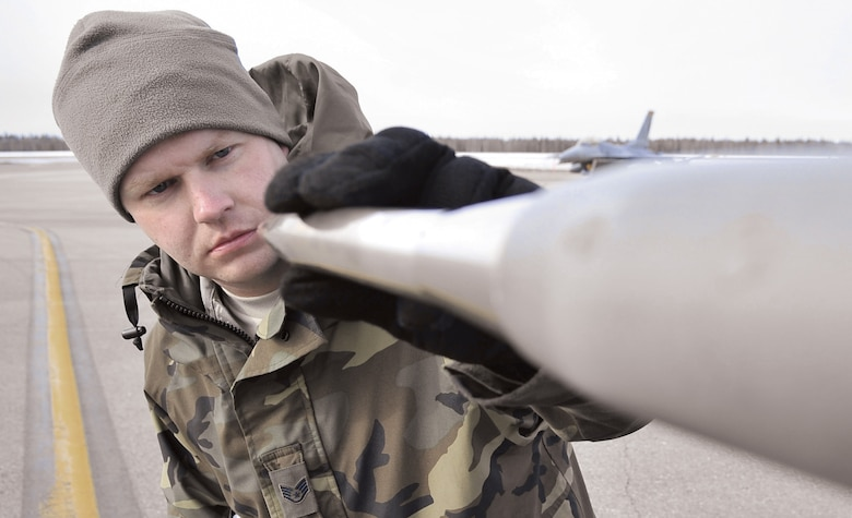 Staff Sgt. James George inspects a pitot tube on an F-16 Fighting Falcon for dents and debris April 17 during Red Flag-Alaska at Eielson Air Force Base, Alaska. Red Flag-Alaska is a Pacific Air Forces-directed field training exercise for U.S. and coalition forces who fly under simulated air-combat conditions. Sergeant George is a crew chief assigned to the Iowa Air National Guard's 132nd Fighter Wing from Des Moines.  (U.S. Air Force photo/Senior Airman Christopher Boitz)
