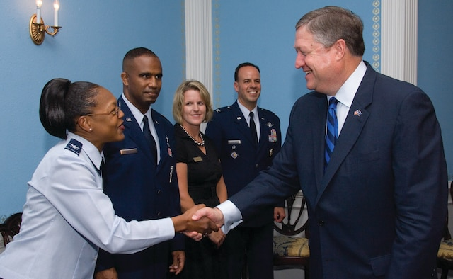 Secretary of the Air Force Michael B. Donley greets Col. Sherry L. Stearns-Boles, spouse of SECAF Leadership Award winner Maj. Sean P. Boles, during a luncheon May 22 at Maxwell's Officers' Club where Secretary Donley presented the awards to graduates of the Air War College, Air Command and Staff College, Squadron Officer School and the Senior NCO Academy. Secretary Donley spent Friday morning speaking to a combined audience of students and leaders who were attending the AWC National Security Forum. Also pictured from left are leadership award recipients Major Boles from ACSC, and Mrs. and Col. Patrick J. Owens from AWC. (U.S. Air Force photo/Melanie Rodgers Cox)