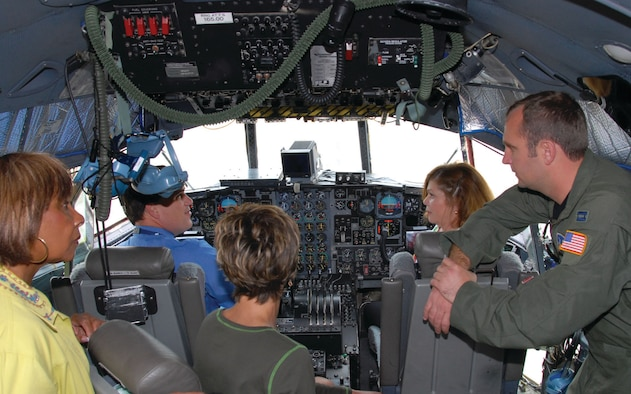 Capt. Derek Shehee, C-130 pilot with the 908th Airlift Wing, shows the flight controls to teachers from Maxwell Elementary School. The teachers took a tour of the base May 22 to become more familiar with the workplaces of many of the parents of their students. Teachers shown from left are Jo Roper, Assistant Principal Brian Perry, Diane Brewster and Becky Gorey. (U.S. Air Force photo/Jamie Pitcher)