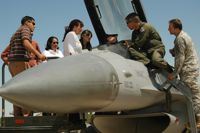 Air National Guard Col. Pete Byrne (top right), vice commander of the 140th Wing, Colorado Air National Guard, gives legislative staffers a peak inside an F-16 Fighting Falcon jet during the staffers? visit with Colorado National Guard leaders May 14, 2009 at Buckley Air Force Base in Aurora, Colo. CONG leaders discussed the numerous missions and roles of the Guard in the nation, state and community, as well as the challenges future leaders will likely face with respect to encroachment and future flight operations at the Air Force base. (Official Colorado National Guard photo by Tech. Sgt. Cheresa D. Theiral, Colorado National Guard/Released)