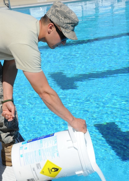 SCOTT AIR FORCE BASE, Ill. -- Putting cyanuric acid into the pools holds the chlorine levels, making sure they are not too high or too low. (U.S. Air Force photo/Airman 1st Class Tristin English)