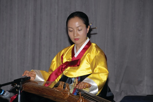 Bo Kyung Lee plays an age-old Korean string instrument called a gayageum during the Asian-Pacific American Heritage month luncheon held Tuesday at the Maxwell Officers' Club here. (U.S. Air Force photo/Bud Hancock)