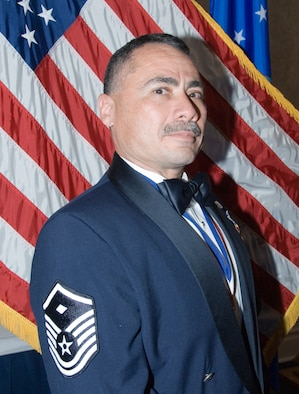 """Master Sgt. Michael Diaz displays the """"Diamond"""" he earned after completing the Air Force First Sergeants Academy at Gunter. Sergeant Diaz now returns to the 147th Mission Support Group at Ellington Field Joint Reserve Base in Houston, Texas where he will apply his new skills as the unit's """"first shirt."""" (U.S. Air Force photo/Melissa Ojeda)"""