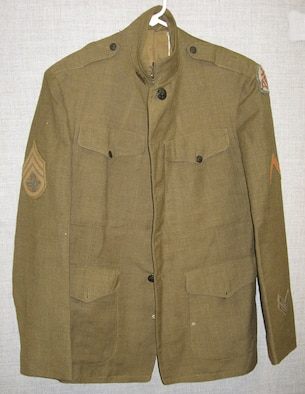 This service coat belonged to William Aulwes who served in World War I. Note the unique balloonist insignia embroidered on the rank chevron. (U.S. Air Force photo)