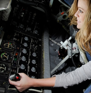 Kelsie Moger, a reporter with KFTA Fox 24, operates the boom on a KC-135K Oct. 14 during a civic tour to Nellis Air Force Base, Nev. The goal of the tour was to observe the 188th Fighter Wing's deployment preparations for the unit's upcoming Aerospace Expeditionary Force (AEF) rotation in Afghanistan in spring 2010.  (U.S. Air Force photo by Capt. Heath Allen/188th Fighter Wing Public Affairs)