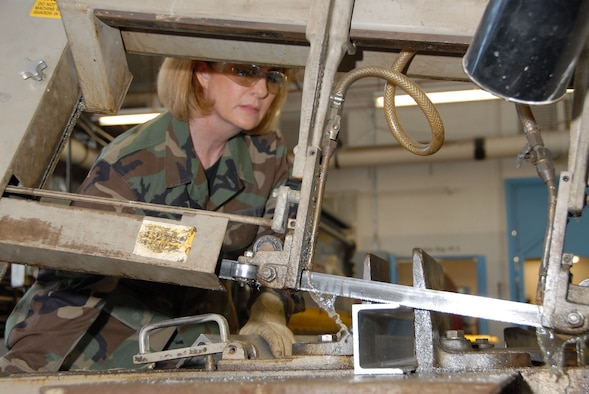 DAYTON, Ohio - Tech. Sgt. Sherri St. John, a reservist with the 315th Maintenance Squadron at Charleston Air Force Base, S.C., saws a piece of stock metal during her two-week stay at Wright-Patterson Air Force Base, Ohio, where she worked in the restoration hangar at the National Museum of the U.S. Air Force. (U.S. Air Force photo)