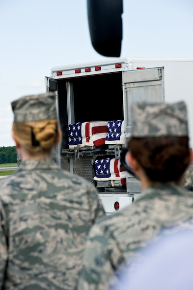 Seven fallen heroes arrived at Dover Air Force Base, Del., July 8, 2009. They were transferred to the Air Force Mortuary Affairs Operations Center where they were processed and prepared for transport to their final destination. (DoD photo/Benjamin Faske)