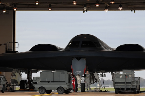WHITEMAN AIR FORCE BASE, Mo. - A B-2 Spirit sits in a hanger as Airman 1st Class Ricky Argenbright, 509th Aircraft Maintenance Squadron, electronic warfare technician, and other maintainers work together performing an operations check on the aircraft prior to flight, Oct 29. 509th AMXS crew chiefs work around the clock with B-2 pilots training and staying prepared for real world missions. Twenty B-2 Spirit aircrafts are assigned to the 509th Bomb Wing. The B-2's primary mission is to attack time-critical targets early in a conflict to minimize an enemy's war-making potential. (U.S. Air Force photo/Senior Airman Kenny Holston)(Released)