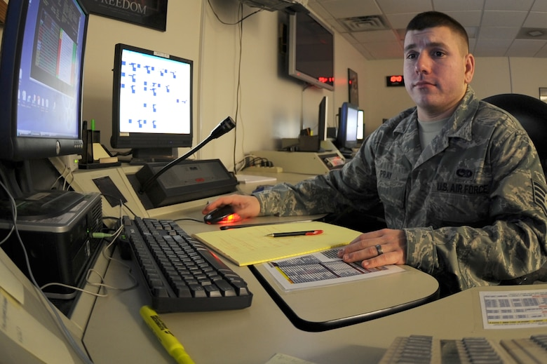 WHITEMAN AIR FORCE BASE, Mo. - Staff Sgt. Daniel Pray, 509th Maintenance Operations Squadron Maintenance Operations controller, coordinates maintenance activities on the B-2 fleet, Nov. 4. The MOC provides an accurate and timely manner reporting of information and coordination of resources in support of aircraft maintenance for the 509th Bomb Wing. (U.S. Air Force photo/Airman 1st Class Carlin Leslie)  (Released)