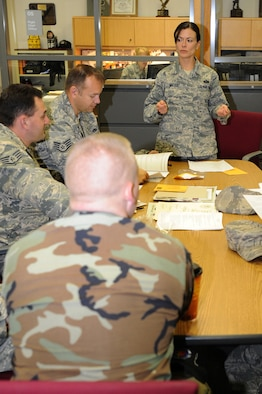 WHITEMAN AIR FORCE BASE, Mo. - Master Sgt. Vicki Miller, 509th Maintenance Operation Squadron NCO in charge of the scheduling element, briefs members of the 509th Maintenance Group on career development course training , Nov. 4. Under the MOS falls the Maintenance Training Flight which is compromised of six hand-selected training managers. They make sure that all 509th Maintenance Group members receive all the formal training necessary to qualify them in skills, knowledge and techniques to maintain and troubleshoot the B-2 Spirit. (U.S. Air Force photo/Airman 1st Class Carlin Leslie) (Released)
