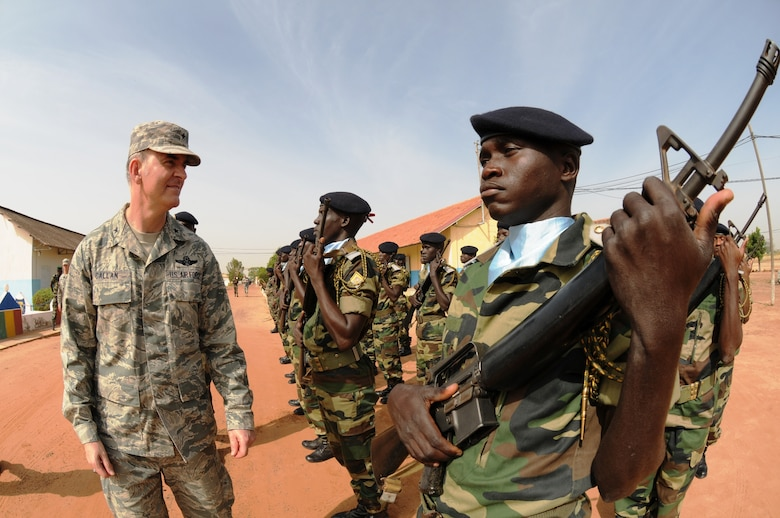 KAOLACK, Senegal -- Members of the 3d Infantry Brigade Honor Platoon greet Brig. Gen. Mike Callan here Oct. 30. General Callan served as guest speaker at the graduation ceremony for the first class of NCO Academy instructors. (USAF photo by Maj. Paula Kurtz)