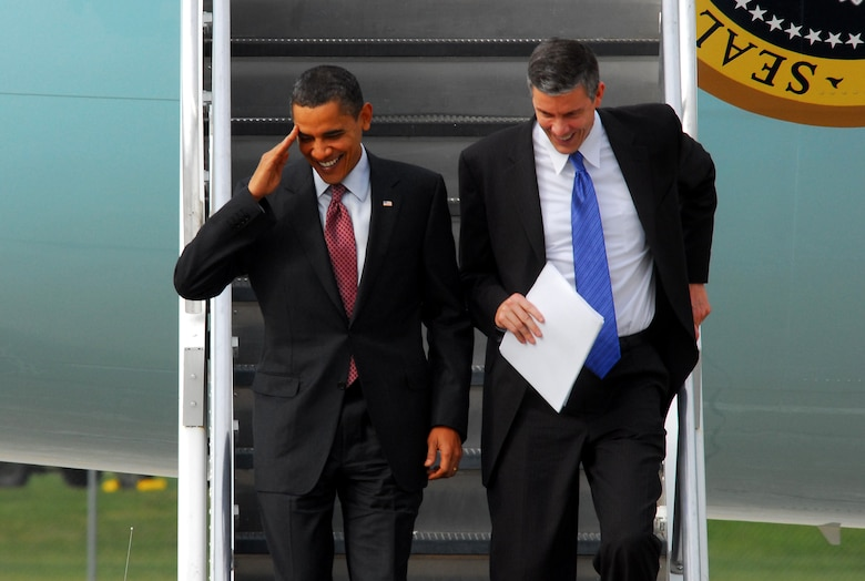 President Barack Obama (left) salutes as he descends down the stairs out of Air Force One with Secretary of Education, Arne Duncan at the 115th Fighter Wing in Madison Wis., Nov. 4, 2009.  The President visited the Air National Guard base on his way to give a speech at Madison's James Wright middle school about education reform.  President Obama's visit marks the first time that a sitting president has visited the base. (U.S. Air Force Photo by Master Sgt. Dan Richardson)