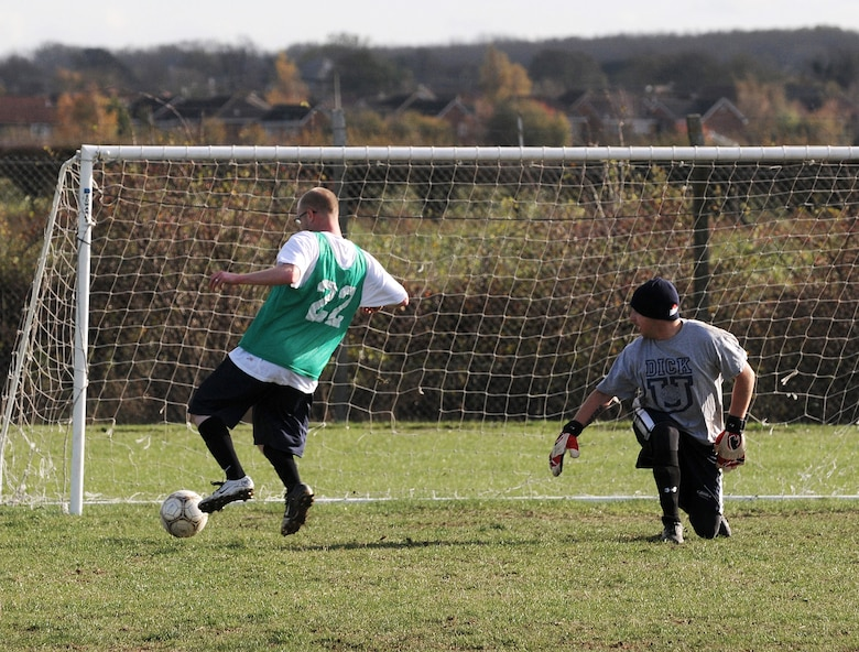 RAF MILDENHALL, England -- Mark Henry, coach for the 100th Security Forces Squadron, scores the winner against the 352nd Maintenance Squadron in intramural soccer at the Hardstand Fitness Center Nov. 4. Two other goals by Angel Santos helped the 100th SFS to a 3-2 victory. (U.S. Air Force photo/Senior Airman Thomas Trower)