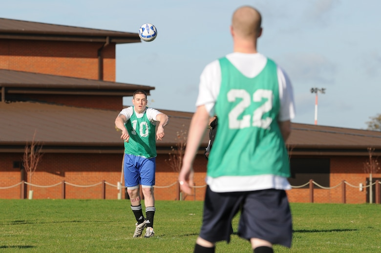 RAF MILDENHALL, England -- Daniel Baker (10), 100th Security Forces Squadron, throws the ball to Mark Henry during an intramural soccer match at the Hardstand Fitness Center Nov. 4. The 100th SFS' late goal from Henry against the 352nd Maintenance Squadron won the game 3-2. (U.S. Air Force photo/Senior Airman Thomas Trower)
