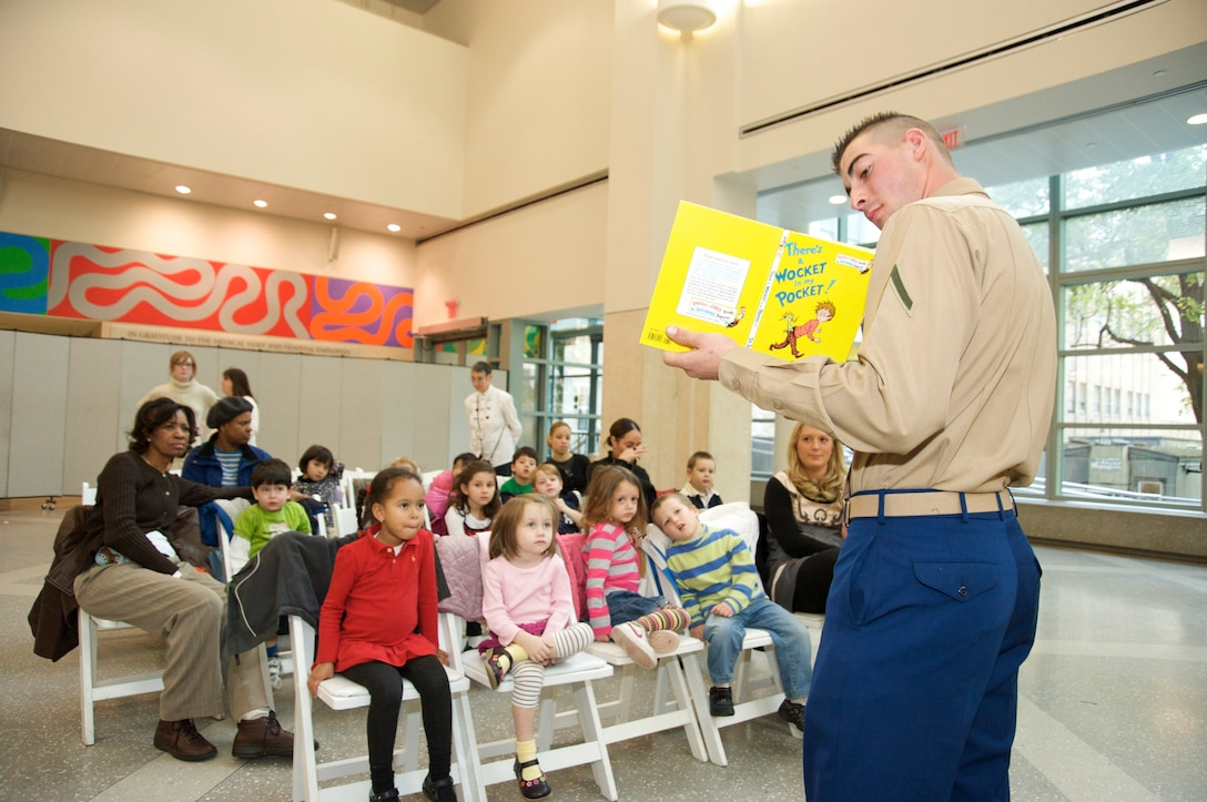 """Pfc. Justin Tullock reads, """"There's a Wocket in my Pocket!,"""" by Dr. Seuss to children of hospital staff at the Morgan Stanley Children's Hospital of New York. Marines from Special Purpose Marine Air Ground Task Force 26 read books to children there Nov. 6, 2009. The Marines are in New York to support the commissioning of USS New York."""