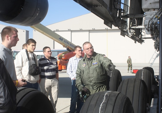 WRIGHT-PATTERSON AIR FORCE BASE, Ohio - Tech. Sgt. Josh Roland, 89th Airlift Squadron, discusses the mechanics of the wheels of a C-5 Galaxy to 24 ROTC cadets from Cornell University, Syracuse University and Rochester Institute of Technology, as they toured the aircraft. (U. S. Air Force photo/Stacy Vaughn)
