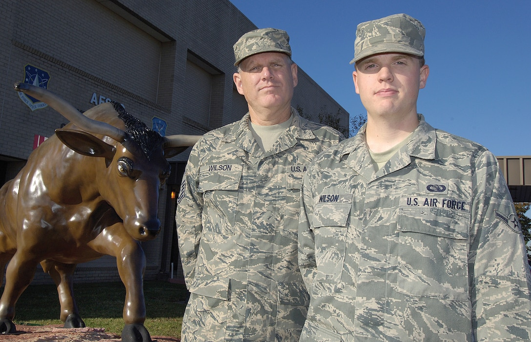 Master Sgt. Dennis Wilson, superintendent of the Base Level Systems Flight in the 31st Combat Communications Squadron is stationed in the same group as his son, Airman James Wilson, who is assigned to the 33rd Combat Communcations Squadron. (Air Force photo by Margo Wright)