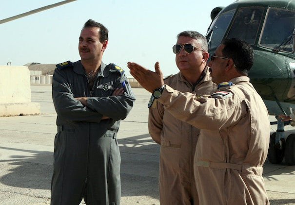 Iraqi Air Force personnel, including sLt. Col. Hammadi Muhammad (center), a pilot and safety officer for the detachment from 4th Squadron, Iraqi Air Force, take their first look at their new home and work place aboard Camp Al Taqaddum, Iraq, Nov. 7, 2009.  The Iraqi Ministry of Defense directed that the detachment come to the base in order to provide a rotary wing transportation capability to the Anbar Operations Command.  (U.S. Marine Corps photograph by Lance Cpl. Melissa A. Latty)