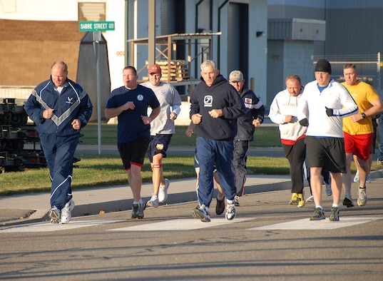 Members of the Utah Air National Guard run to earn money for the Fischer House foundation on November 8.  The chiefs on base sponsored the run and others participated to support the donations given to the charity fundraiser.  U.S. Air Force Photo by: Staff Sgt. Emily Monson (RELEASED)