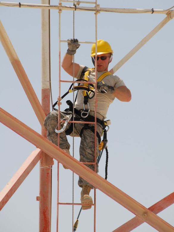 Tech. Sgt. Michael Gray climbs a communications radio antenna to capture video footage from a creative perspective Aug. 28, 2009, while deployed to Southwest Asia. (U.S. Air Force Photo by Tech. Sgt. Jason Edwards)
