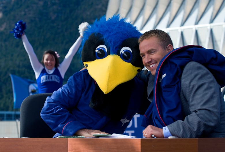 "ESPN college football analyst Lee Corso wears the U.S. Air Force Academy's ""The Bird"" mascot head after predicting an Academy win with fellow analyst Kurt Herbstreit during a broadcast of ESPN's ""College GameDay"" from the U.S. Air Force Academy Nov. 7, 2009, before the Air Force vs. Army football game in Colorado Springs, Colo. (U.S. Air Force photo/Staff Sgt. Bennie J. Davis III)"