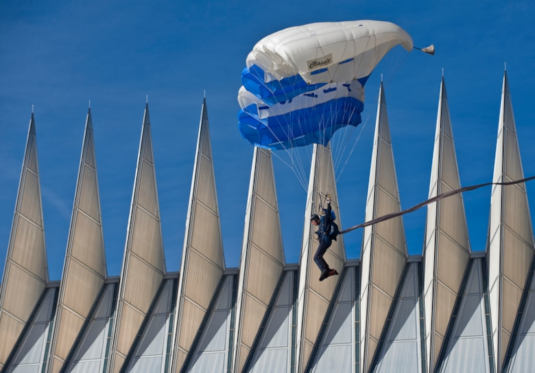 "A member of the U.S. Air Force Academy's Wings of Blue Parachute team maneuvers past the spires of the Cadet Chapel toward a successful landing Nov. 7 at the Terrazzo during ESPN's ""College GameDay"" broadcast from the Academy for the Air Force vs. Army football game in Colorado Springs, Colo. (U.S. Air Force photo/Staff Sgt. Bennie J. Davis III)"