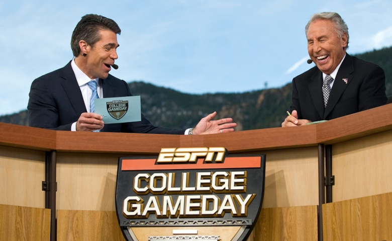 "Chris Fowler (left) and Lee Corso, two of ESPN's ""College GameDay"" broadcasters joke during a live broadcast from the U.S. Air Force Academy Nov. 7 before the Air Force vs. Army football game in Colorado Springs, Colo. The latest Academy visit is part of ESPN's salute to veterans of the U.S. armed forces. (U.S. Air Force photo/Staff Sgt. Bennie J. Davis III)"