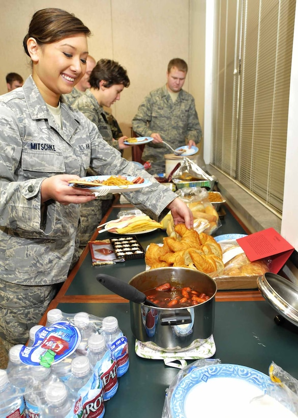 Airman 1st Class Jhangmi Mitschke, 141st Medical Group, partakes in the Diversity Council's ethnic luncheon. The luncheon provided members the opportunity to bring in traditional dishes and discuss their cultural significance. Fairchild AFB, Wash., Nov. 8, 2009. (U.S. Air Force photo by Staff Sgt. Anthony Ennamorato/Released)