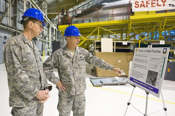Senior Master Sgt. Bryan Ford, 512th Maintenance Squadron, briefs Maj. Gen. James T. Rubeor, 22nd Air Force commander, on Air Force Smart Operations for the 21st Century processes in the 512th Maintenance Group. AFSO 21 is designed to maximize value and minimize waste. General Rubeor visited several maintenance areas during his visit to the 512th Airlift Wing Nov. 5-8.