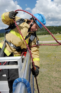 Firefighter Stacy Billapando from the Colorado Springs, Colo., Fire Department hoists a rope attached to a 45-pound fire hose from five stories up during a firefighter challenge at the Air Force Academy June 27, 2009. Ms. Billapando, the world's top-ranked female firefighter, will join the Academy ladies' tandem firefighter team at World Firefighter Combat Challenge XVIII, scheduled to be held in Las Vegas Nov. 16-20. (U.S. Air Force photo/Mike Kaplan)