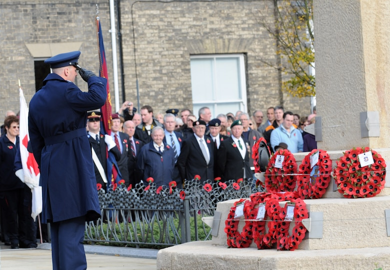 RAF MILDENHALL, England -- Col. Chad Manske, 100th Air Refueling Wing commander, salutes a poppy wreath at a Remembrance Day ceremony at Angel Hill, Bury St. Edmunds Nov. 9. Servicemembers from RAFs Mildenhall and Lakenheath participated in a military procession with British forces before the ceremony. The poppy flower is a traditional symbol of remembrance of World War I. It was at bloom across some of the worst battlefields in the war. (U.S. Air Force photo/Senior Airman Thomas Trower)