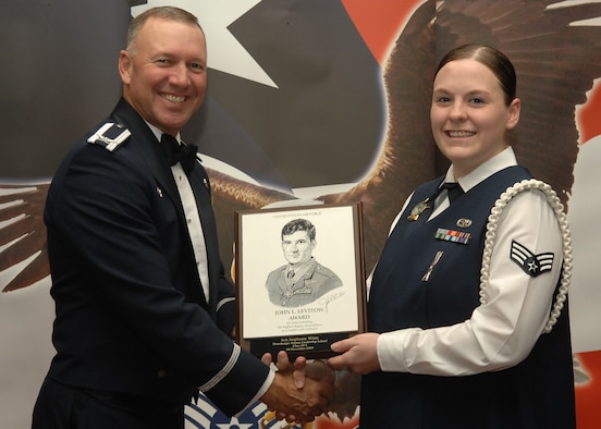 SPANGDAHLEM AIR BASE, Germany – Col. Tip Wight, 52nd Fighter Wing commander, presents the John L. Levitow Award to Senior Airman Stephanie Witt, 52nd Communications Squadron, during the Airman Leadership School class 10-1 graduation Nov. 5 at Club Eifel. The John L. Levitow Award is the premier honor given to the finest graduate of every Air Force Leadership School. (U.S. Air Force photo/Airman 1st Class Nick Wilson)