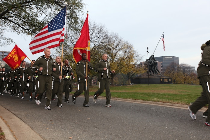 Commandant of the Marine Corps Gen. James T. Conway leads a formation of hard charging devil dogs past the Marine Corps War Memorial Nov. 10 for a motivational birthday run. This day marked the 234th anniversary of when a committee from the Continental Congress met in a Philadelphia tavern and stood up two battalion of Marines, an orginazation that is now known as one of the world's most elite fighting force.